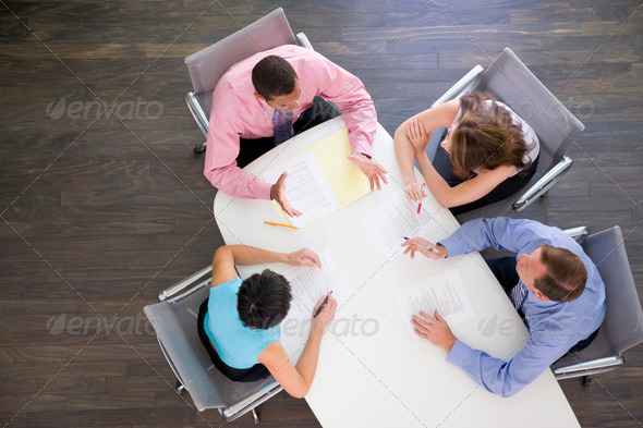 Four businesspeople at boardroom table - Stock Photo - Images