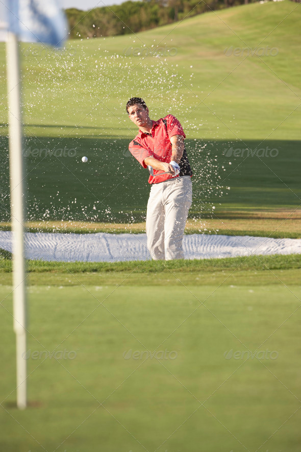 Male Golfer Playing Bunker Shot On Golf Course - Stock Photo - Images