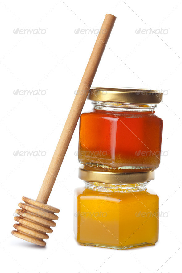 honey in bottles and wooden dipper isolated - Stock Photo - Images
