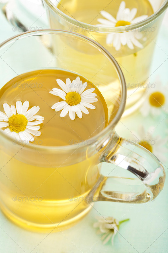 cup of herbal tea with camomile flowers - Stock Photo - Images