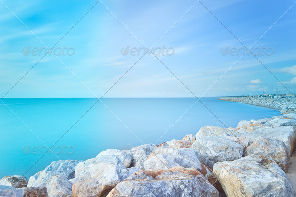 San Vincenzo harbor rocks bay. Long exposure photography. Tuscany, Italy. - Stock Photo - Images