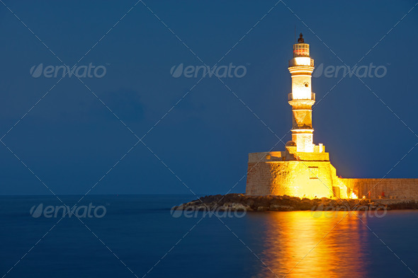 The lighthouse of Chania at night - Stock Photo - Images