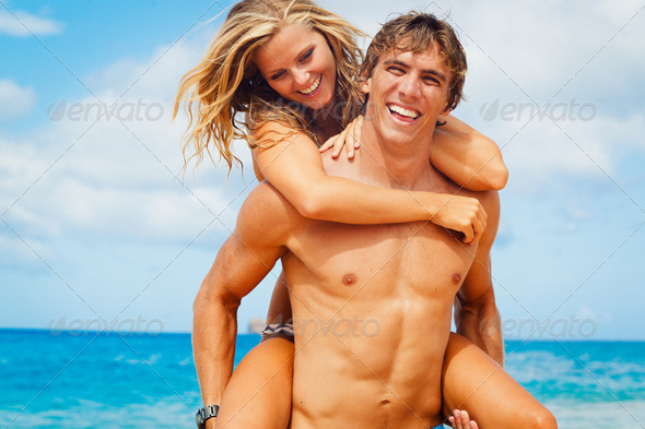 Young Couple on Tropical Beach - Stock Photo - Images