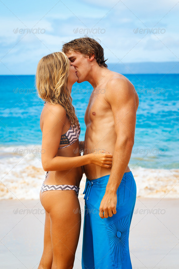 Young Couple Kissing on Tropical Beach - Stock Photo - Images