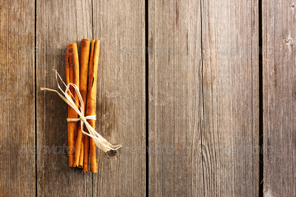 Cinnamon sticks over wooden table - Stock Photo - Images