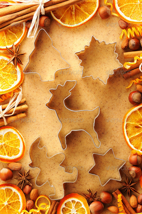 Christmas spices and cookie cutters over gingerbread dough - Stock Photo - Images
