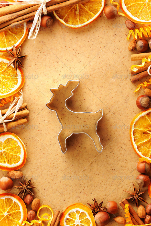 Christmas spices and cookie cutter over gingerbread dough - Stock Photo - Images