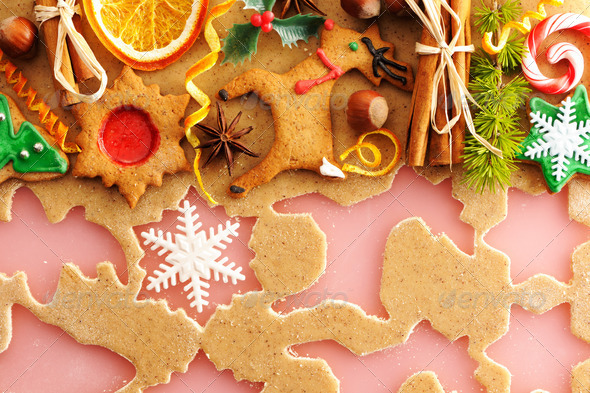 Christmas spices and cookies over gingerbread dough - Stock Photo - Images