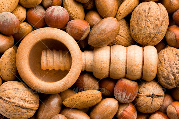 wooden nutcracker and nuts - Stock Photo - Images