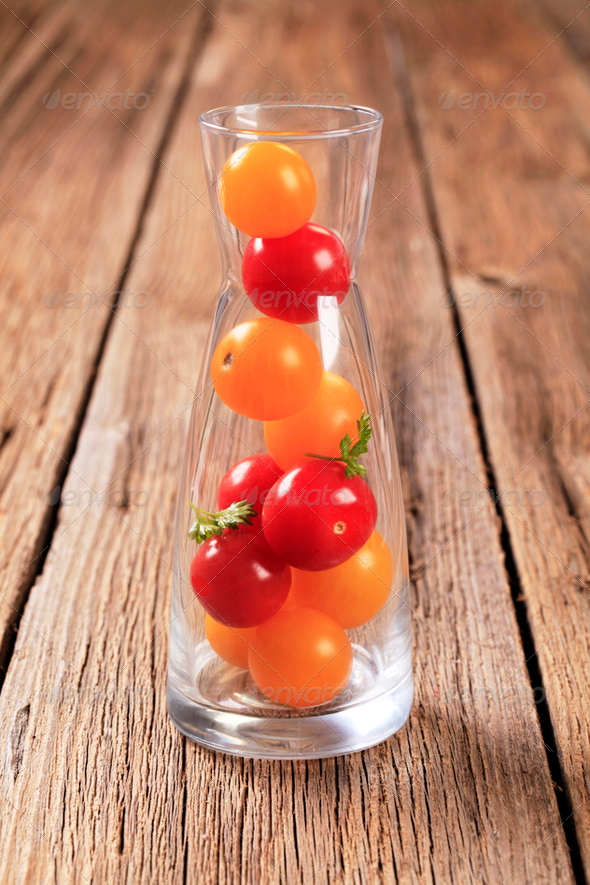 Cherry tomatoes in a carafe - Stock Photo - Images
