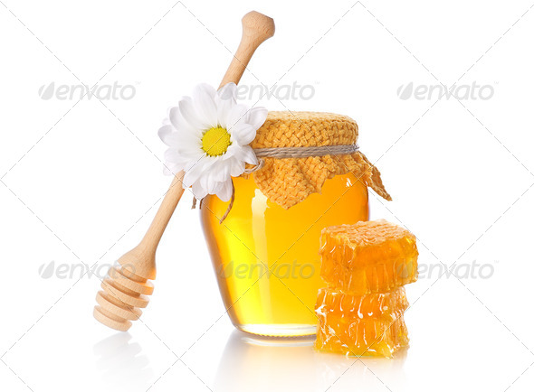 Honey jar with honey dipper - Stock Photo - Images