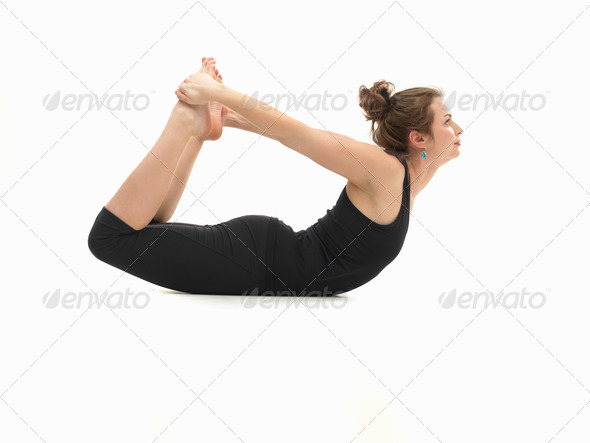 woman in lying yoga posture - Stock Photo - Images