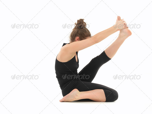 young woman in yoga posture - Stock Photo - Images