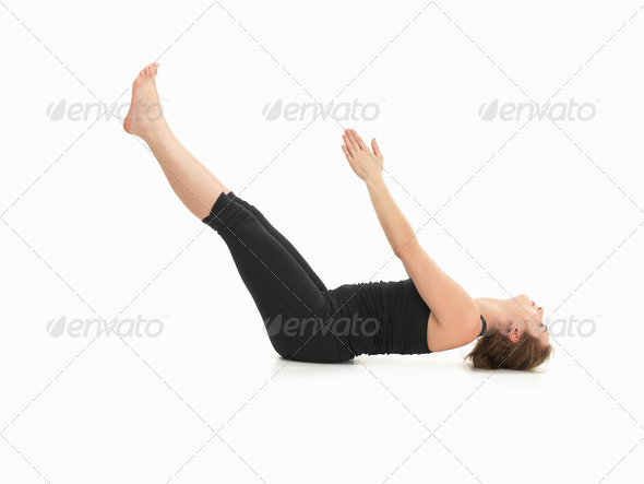 demonstration of advanced yoga posture - Stock Photo - Images