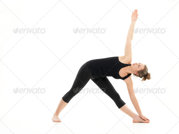 stretching and strength yoga pose - Stock Photo - Images