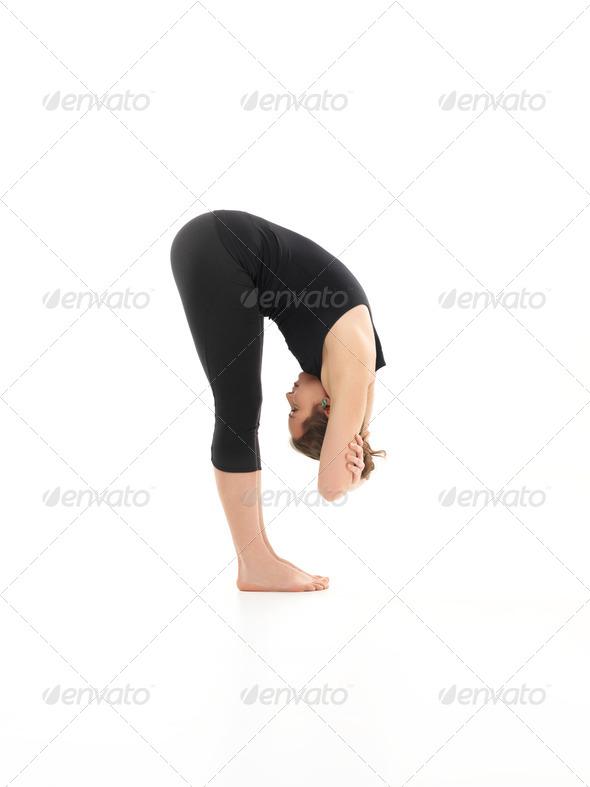 bent forward yoga pose - Stock Photo - Images
