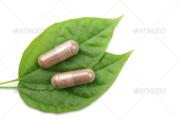 macro of prescription pills over green leaf isolated - Stock Photo - Images