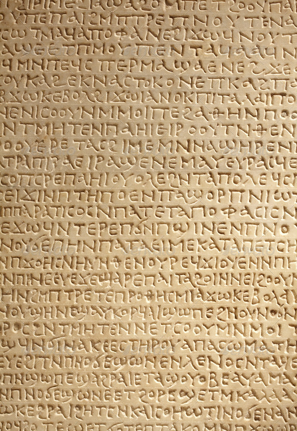 Ancient greek writing on stone - Stock Photo - Images