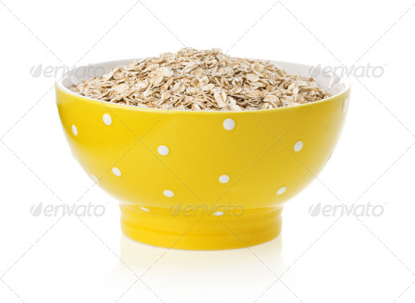 bowl of oat flake on white - Stock Photo - Images
