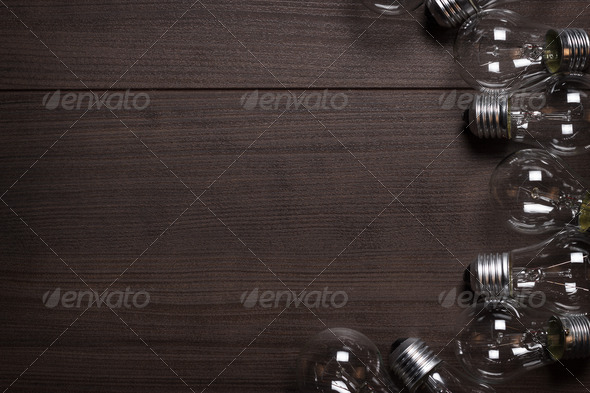 Bulbs Over Wooden Background - Stock Photo - Images