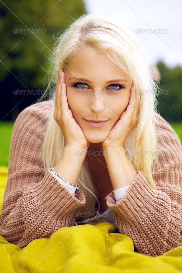 Beautiful girl lying in a park - Stock Photo - Images