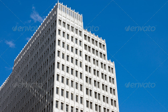 Skyscraper in front of a blue sky - Stock Photo - Images