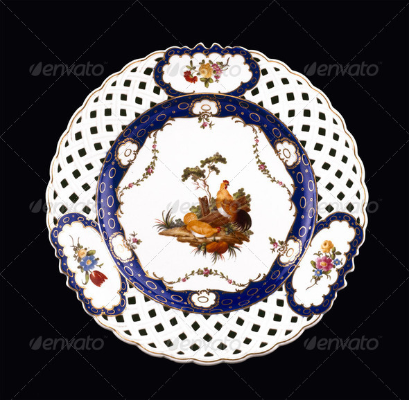 Antique plate on black background - Stock Photo - Images