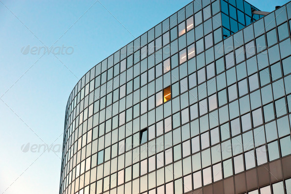 Modern office building at sunrise - Stock Photo - Images