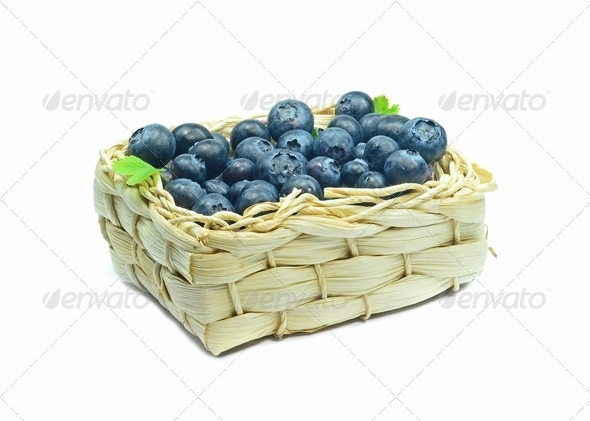 Blue Berries in a Basket - Stock Photo - Images