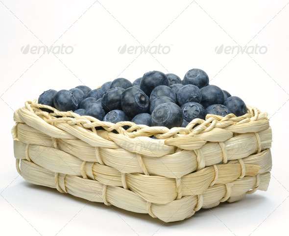 Blueberries in a Straw Basket - Stock Photo - Images
