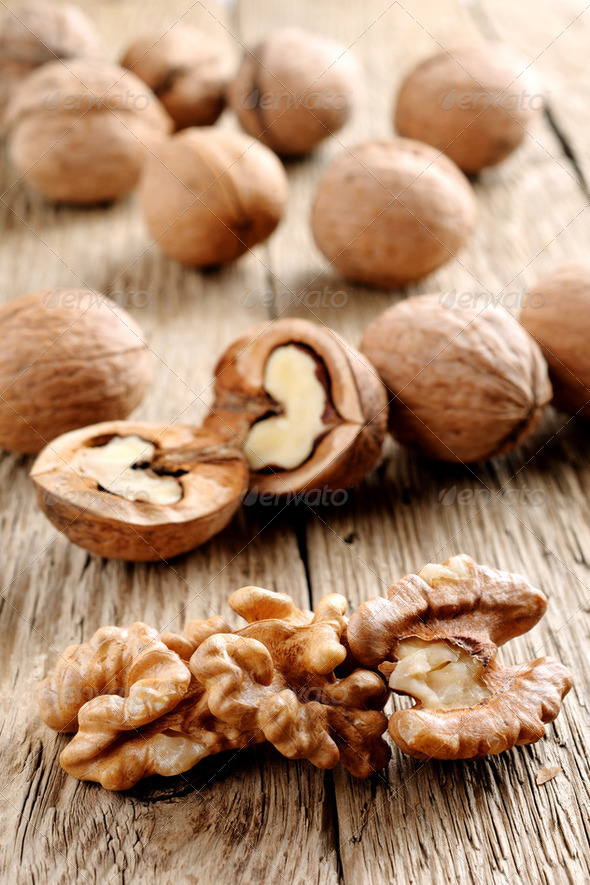 Walnuts on wooden background - Stock Photo - Images