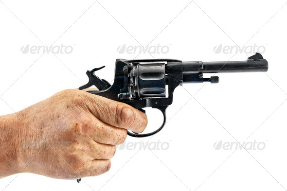Revolver in hand - Stock Photo - Images