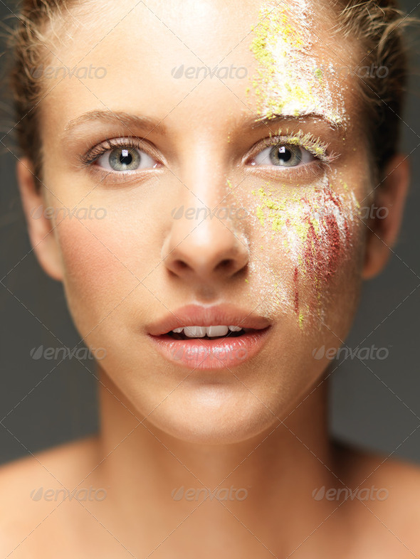 beautiful woman loose colored powders on face - Stock Photo - Images