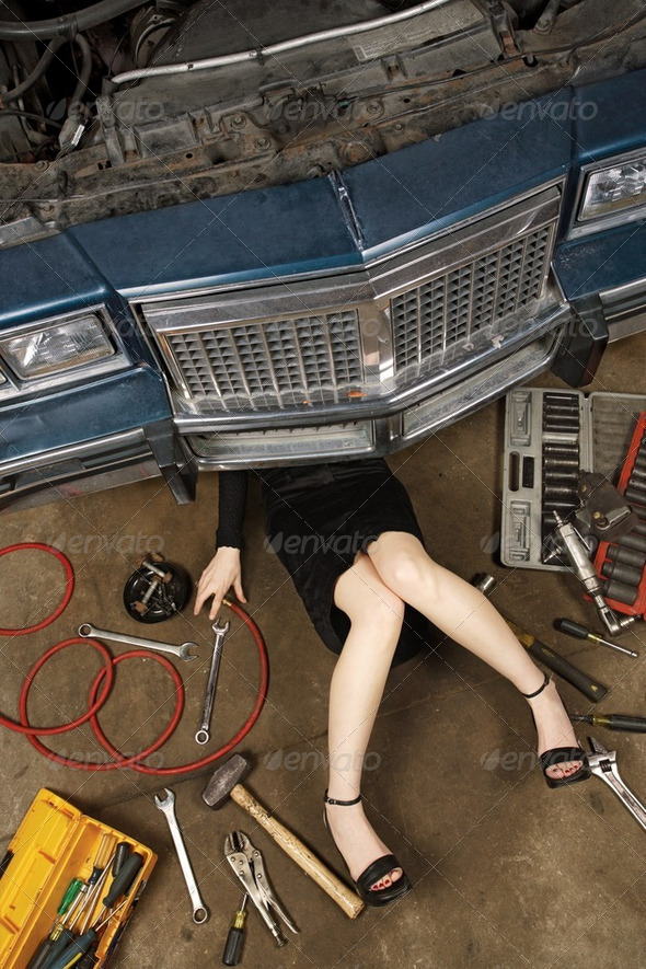 female fixing her car - Stock Photo - Images