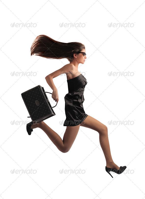 Fashionable Girl Running - Stock Photo - Images