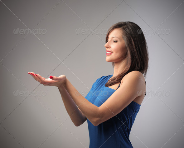 Woman Holding - Stock Photo - Images