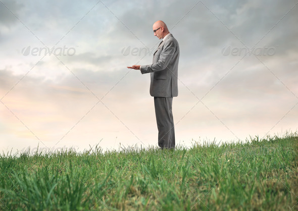 Businessman Holding - Stock Photo - Images