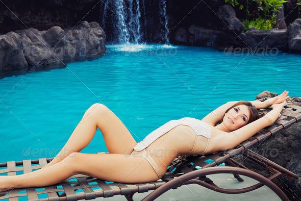 Beautiful Girl Relaxing at Tropical Resort - Stock Photo - Images