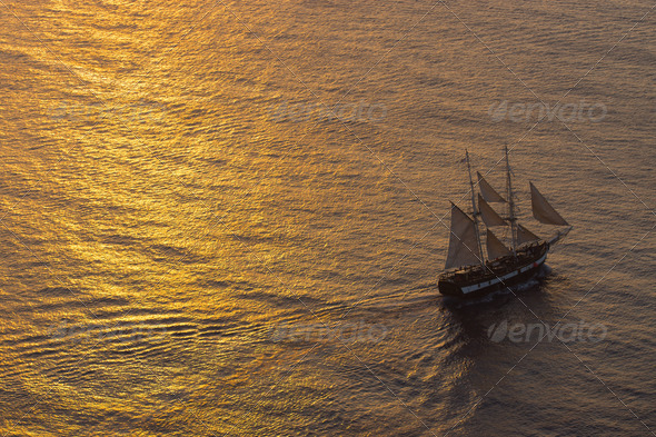 Ship sailing at sunset  - Stock Photo - Images
