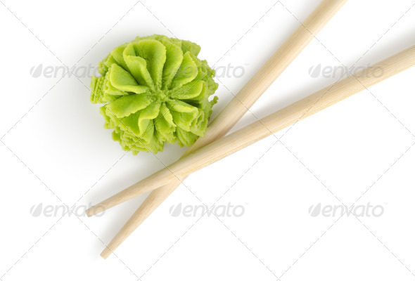 Wooden chopsticks and wasabi isolated - Stock Photo - Images
