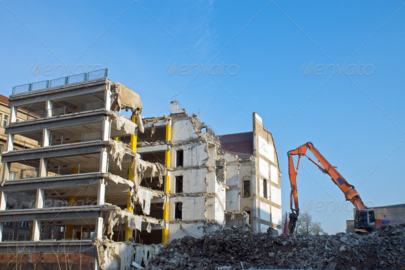 Demolition of a building with excavator - Stock Photo - Images