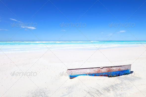 Old boat on white tropical sunny beach and a blue sky - Stock Photo - Images