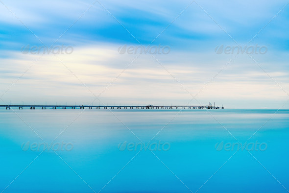 Industrial pier on the sea. Long exposure photography. - Stock Photo - Images