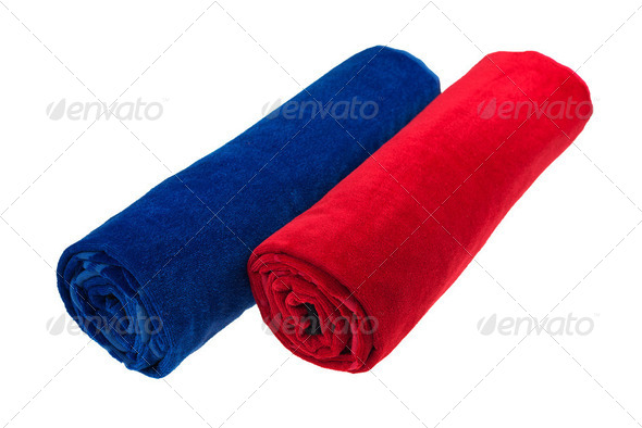 Two blue and red rolled up beach towel isolated - Stock Photo - Images
