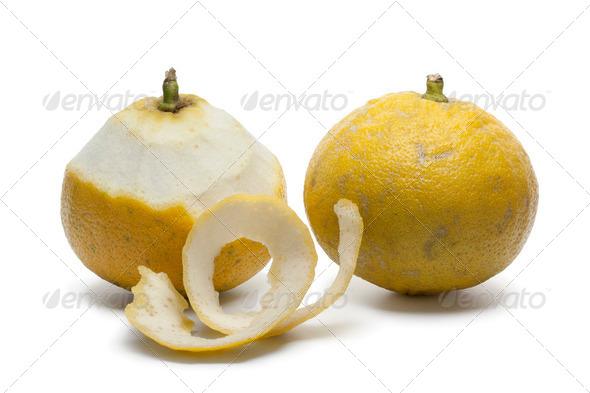 Bergamot oranges with a peeled skin - Stock Photo - Images