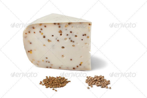 Piece of Goats cheese with Coriander and Fenugreek - Stock Photo - Images