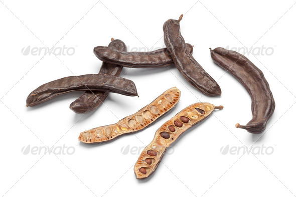 Whole and half Carob pods - Stock Photo - Images
