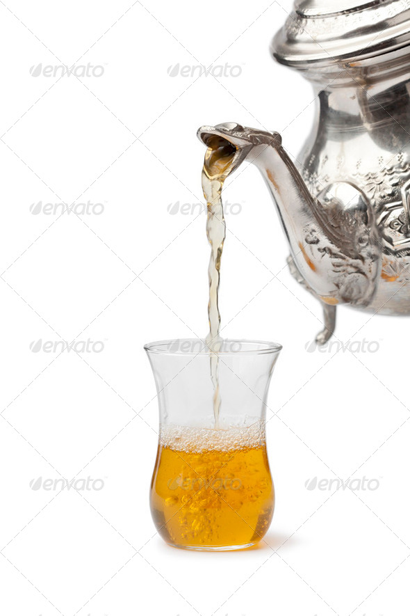 Traditional Moroccon mint tea poured in a glass - Stock Photo - Images