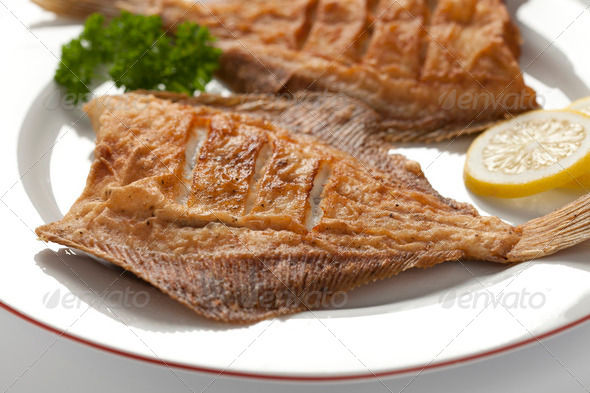 Dish with fried plaice - Stock Photo - Images