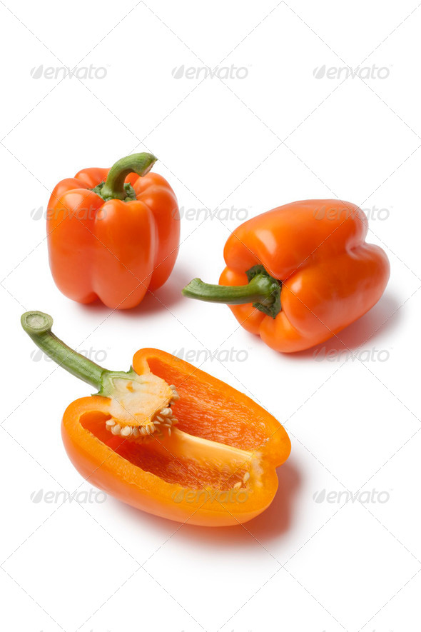 Whole and half orange bell peppers - Stock Photo - Images